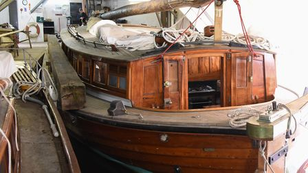 The stern of the pleasure wherry, Ardea, 90-years-old this year, moored at the Wherry Yacht Charter
