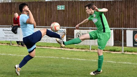 Joel Watts goes for a bouncing ball during Gorleston's 2-1 defeat at Godmanchester. Picture: David H