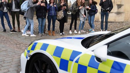 French students with the Norfolk police's Porsche Cayman GT4 to be used in teaching road safety to y
