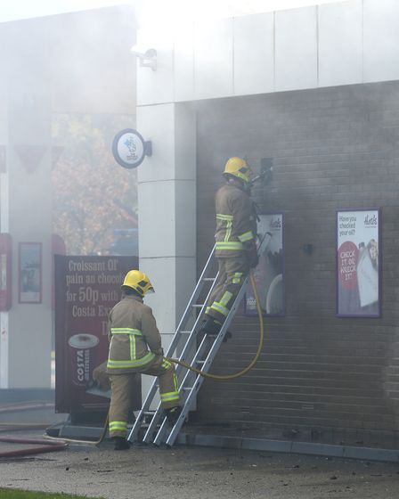 Police and fire crews at a fire at the Esso fuel garage on the Fiveways roundabout at Barton Mills.