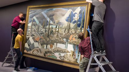 The installation of the Paul Nash painting,The Menin Road, at the Sainsbury Centre for Visual Arts i