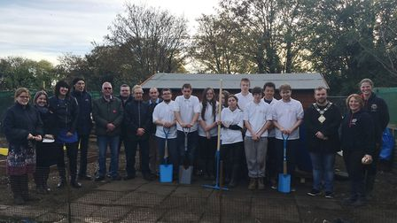 Prince's Trust Team 137 hand over the key to the allotments in Station Lane, Thetford, which they re