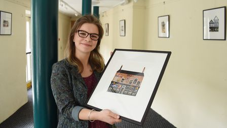 Artist Caitl�n Law with some of her collages of Norwich pubs on exhibition Norwich Playhouse. Pictur