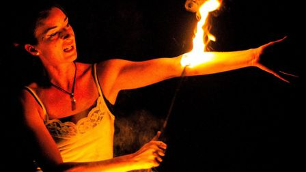 Penny Miracle, also known as Pyro Penny, undertaking body burning. Photo by Mark Barley