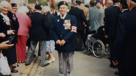 Normandy veteran and member of the Royal Norfolk Regiment, Leonard Cogman, centre. Picture: Courtesy