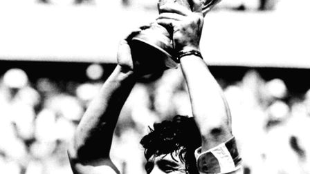 Maradona, seen here with the World Cup in 1986, never did sign to play for a Russian side. Picture: