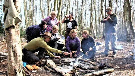 The group with the two scout guides around the campfire. Picture Maurice Gray