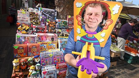 Walker's Toys stall on Norwich Market. Owner Simon Walker with the Pie Face game.Picture: ANTONY KE