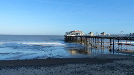 'As The Tide Goes Out'. At Cromer pier. Photo by Lesley Buckley.