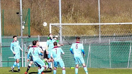 Spixworth's keeper punches clear an Acle corner during last week's 3-0 win. Picture: Richard Giles.