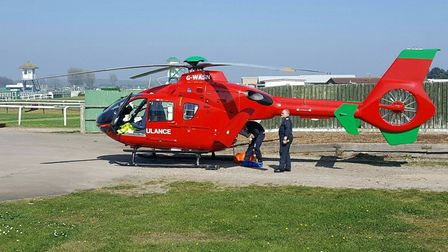 The air ambulance landed at Great Yarmouth Raceourse to help a man in a nearby property whose hand w