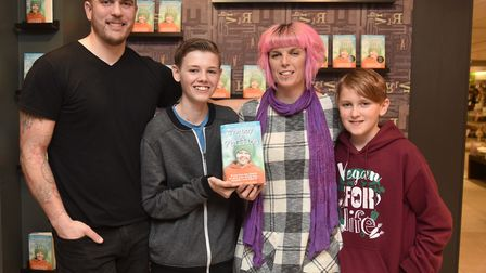 Callie Blackwell signs copies of her new book at Jarrolds. L-R Simon, Deryn, Callie and Dylan Blackw