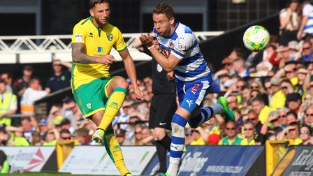 Reading skipper Chris Gunter tries to block City's Mitchell Dijks. Picture by Paul Chesterton/Focus