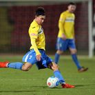 Michael Clunans penalty set the ball rolling for King's Lynn Town. Picture: Simon Moore/Focus Image