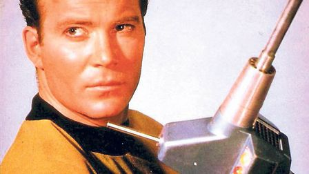 Captain James T Kirk with a weapon