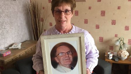 Denise Bussey holding a photo of her late husband, David Bussey: Pictures David Bale