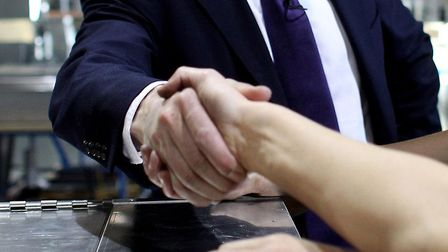 File photo of two people shaking hands. Photo: Oli Scarff/PA Wire