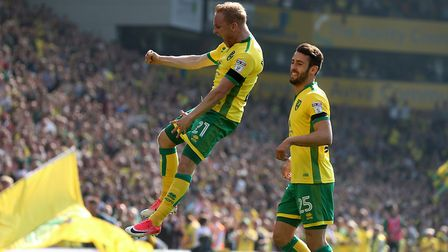 Alex Pritchard goes airborne to celebrate his second goal against Reading. Picture by Paul Chesterto