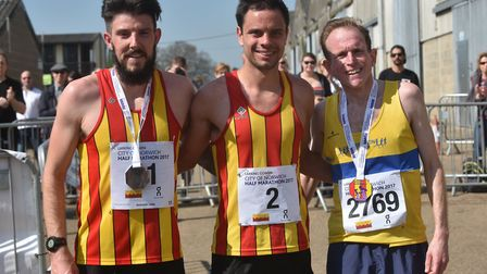 The first three home, from left, runner-up Ash Harrell, City of Norwich AC team-mate and winner Pier