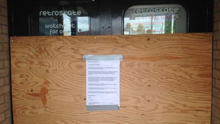 The front of Retroskate has been boarded up and a sign put up. Photo: George Ryan