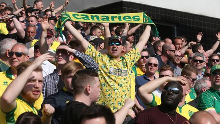 The home fans enjoy the first half goal fest at Carrow Road. Picture by Paul Chesterton/Focus Image