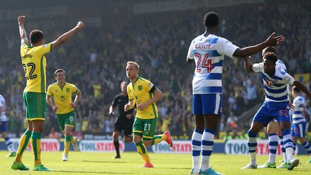 Reece Oxford of Reading reacts as Alex Pritchard of Norwich runs off to celebrate scoring his side's