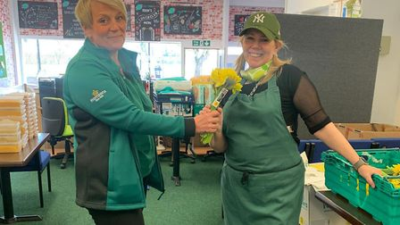 Jane from Morrisons donating flowers to Nina Pierson from Eat That Frog