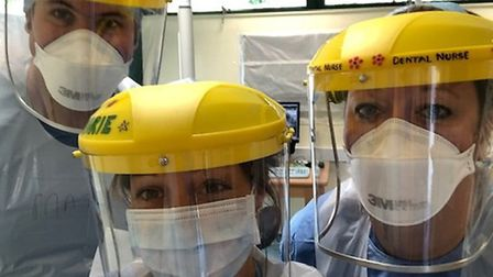 Oral surgery emergency hub staff in PPE