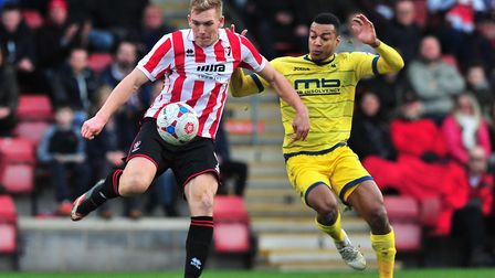 Danny Wright of Cheltenham Town battles for the ball with Durrell Berry of Torquay United in Decembe