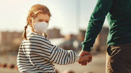 A girl and her father during coronavirus outbreak
