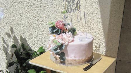 Peggy's birthday cake was a gift from her carers at Maids to Care