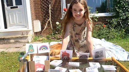 Ezme selling her cards in aid of Torbay Hospital's Louisa Cary Ward