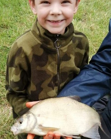 Six-year-old Austin Smith landed his first fish, a bream