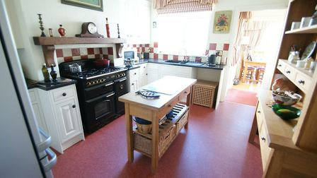The kitchen features a master range cooker and five-burner hob