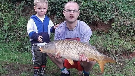 Chris and Alfie Pearce with their 15lb 11oz carp