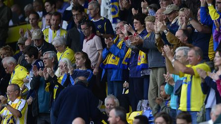 Torquay United fans on the Bristows Bench at Plainmoor. Photo: Dan Mullan/Pinnacle