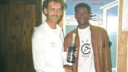 Linden Joseph presents Neil Murrin with a peace-making bottle of champagne