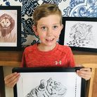 Ralph Carlberg with his drawings
