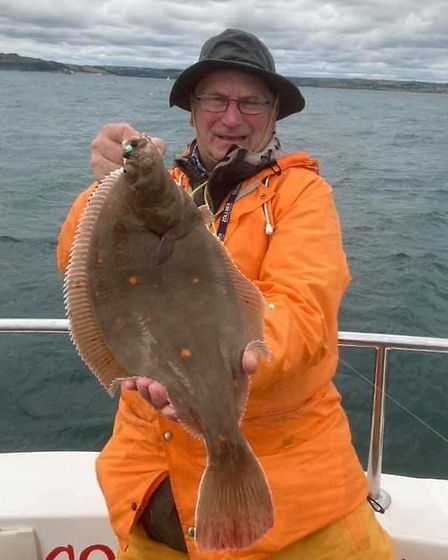 Roy Biggs with a 3lb 8oz plaice caughter from Our Joe'l
