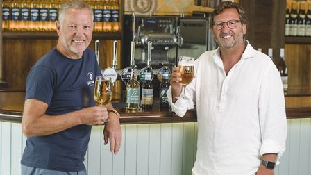 John Tiner and Mitch Tonks celebrate the drinks partnership between Rockfish and Salcombe Brewery