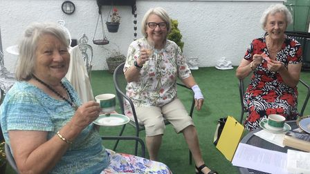 In president�s garden for the August executive meeting are, left to right: president Patricia, secre