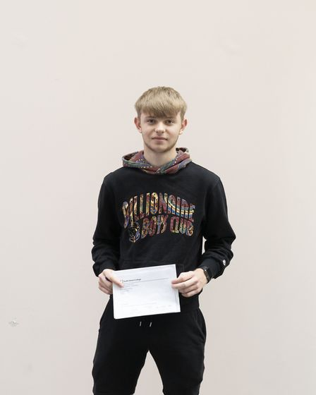 Benjamin Henderson receives his results
