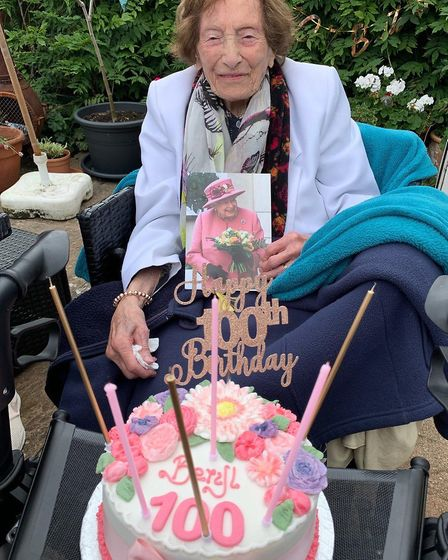A special cake and 100th birthday card from the Queen for Beryl Adams
