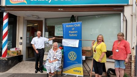The Preston Rotary Club makes its donation to the Crafty Fox Cafe