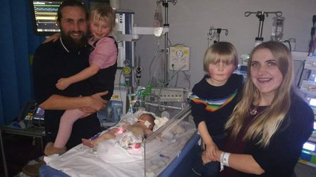 Hendrix Washbrook with mum Lauren, dad James, brother Lennon and sister Lyla