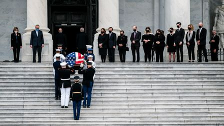 A military honor guard team carries the casket of the late Supreme Court Justice Ruth Bader Ginsburg into the US Capitol