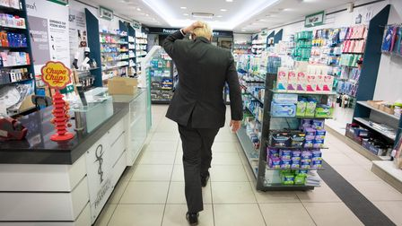 Prime Minister Boris Johnson meets shoppers and shopkeepers during a visit to his constituency in Uxbridge