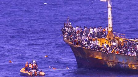 The US Coast Guard rescues several migrants who had jumped off a vessel that was intercepted