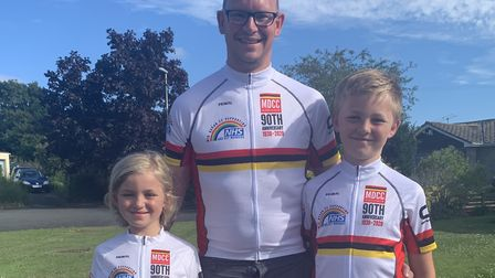 Maddy, dad Rob and Bayley Woodger show off the Mid-Devon CC's new 90th anniversary jersey
