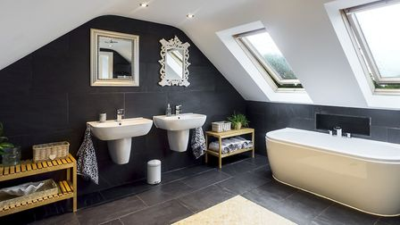 The family bathroom with rain shower, freestanding bath and double sinks